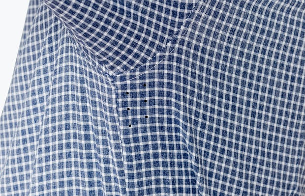 Men's Navy Grid Nylon Aero Dress Shirt on Model Raising Arm in Close-Up of Underarm Ventilation