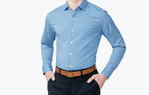 Men's Blue Gingham Aero Dress Shirt on Model Facing Forward with Hands in Pant Pockets