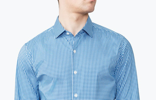 Men's Blue Gingham Aero Dress Shirt on Model in Close-Up Facing Forward