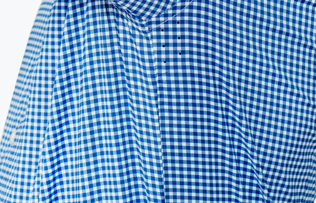 Men's Blue Gingham Aero Dress Shirt on Model Raising Arm in Close-Up of Underarm Ventilation