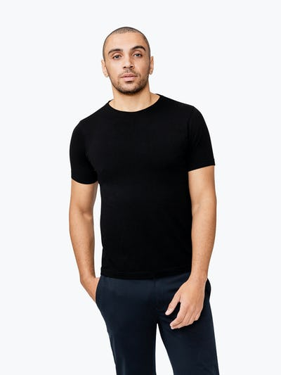 Men's Black Atlas Crew Neck Tee model with hand in pocket