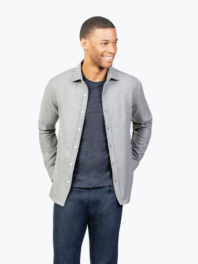 Men's Grey Fusion Overshirt model facing forward with hands in back pockets