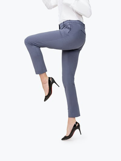 Women's Indigo Heather Kinetic Slim Pants on Model Jumping in Air with Knee Raised