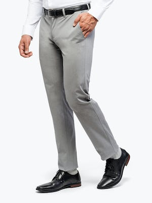 Men's Grey Heather Kinetic Pants on Model Facing Left with hand in pocket