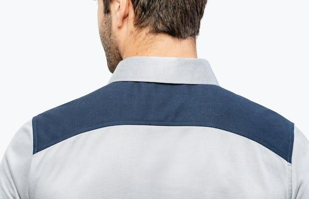 Men's Blue Block Apollo Polo on Model Facing Backward