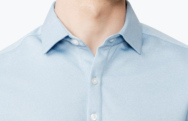Close up of Men's Blue Heather Apollo Polo on model