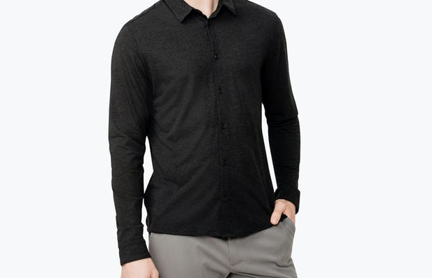 Men's Black Composite Merino shirt model facing forward with hand in pocket