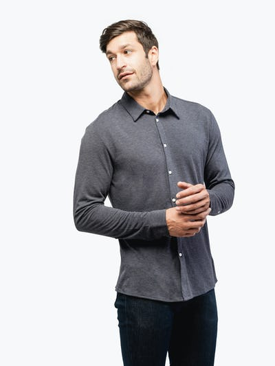 Men's Dark Grey Composite Merino shirt model facing forward and to the left looking right