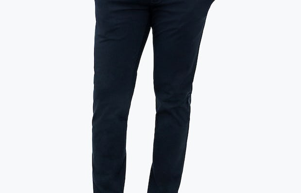 Men's Navy Momentum Chino on Model Facing Forward with Hands in Pockets