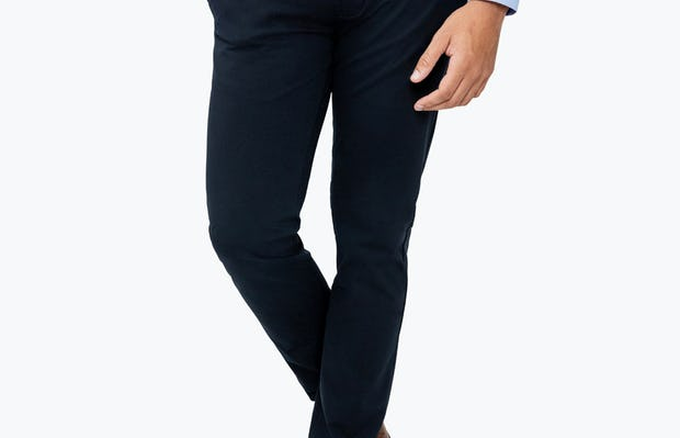 Men's Navy Momentum Chino on Model Walking Forward with Hand in Pant Pocket
