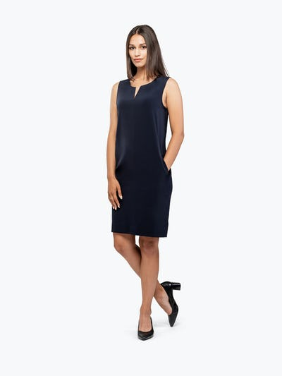 Women's Black Swift Sleeveless Dress on Model with Hand in Her Left Pocket