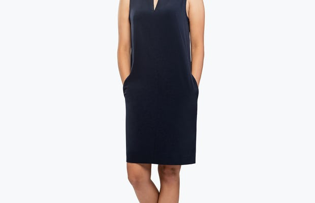 Women's Black Swift Sleeveless Dress on Model with Hands in Her Pockets
