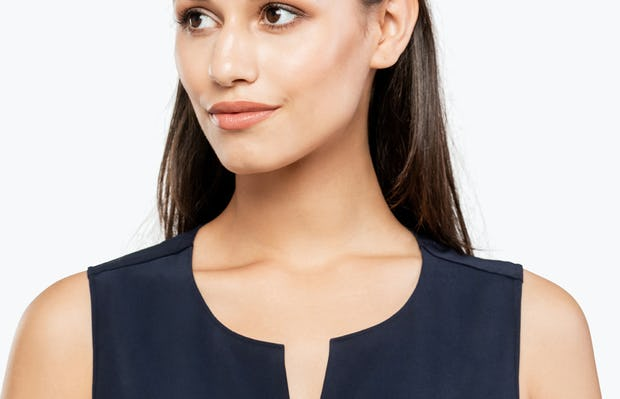 Women's Black Swift Sleeveless Dress on Model in Close-up of Front Collar