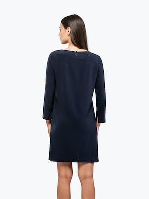 Women's Navy Swift 3/4 Sleeve Dress on Model Facing Backward