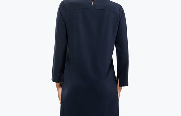 Women's Navy Swift 3/4 Sleeve Dress on Model Facing Backward