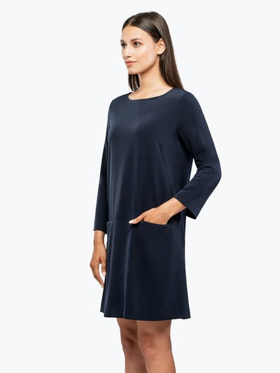 Women's Navy Swift 3/4 Sleeve Dress on Model Facing Left