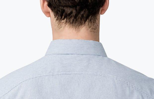 Men's Blue Twill Stripe Nylon Aero Dress Shirt on Model Facing Backward in Close-Up of Curved Back Yoke