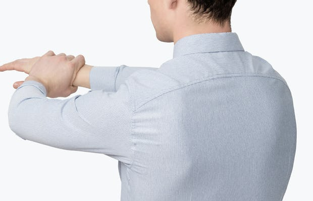 Men's Blue Twill Stripe Nylon Aero Dress Shirt on Model Facing Backward with Arms Stretched Forward to Show Stretch