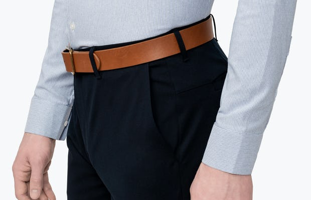 Men's Blue Twill Stripe Nylon Aero Dress Shirt on Model Facing Left in Close-Up of Shirt Tucked Into Pants
