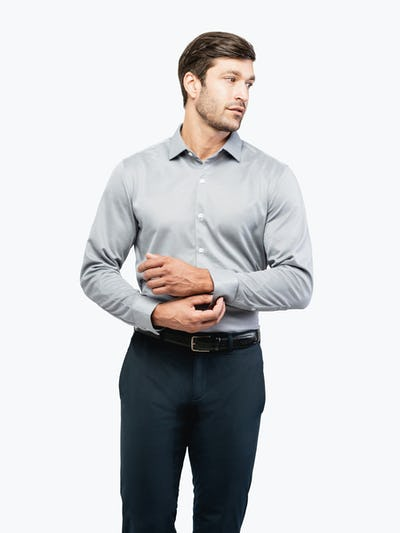 Men's Medium Grey Heather (Brushed) Apollo Dress Shirt on Model Facing Forward Adjusting Sleeve Cuffs