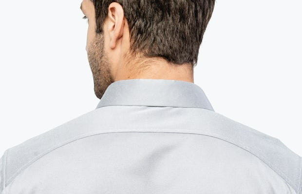Men's Medium Grey Heather (Brushed) Apollo Dress Shirt on Model Facing Backward in Close-Up of Curved Back Yoke and Collar