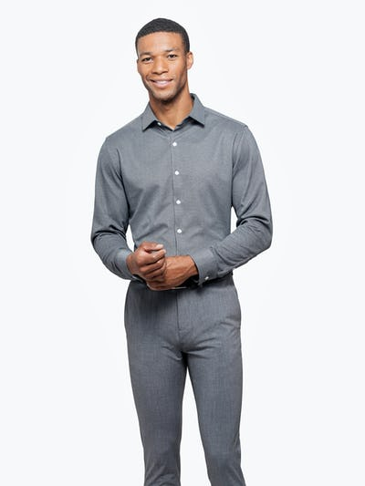 Men's Charcoal Oxford Brushed Apollo Dress Shirt on Model Facing Forward Adjusting Sleeve Button