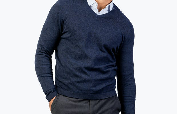 Men's Navy Static V-Neck Sweater model wearing collared shirt with hand in pocket