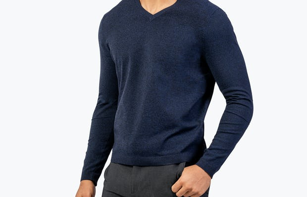 Men's Navy Static V-Neck Sweater model with thumb in pocket