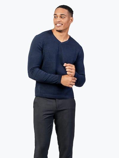 Men's Navy Static Atlas Sweater on model facing forward adjusting sweater sleeve