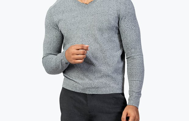 Men's Grey Static v-Neck Sweater model facing forward  arm at chest height
