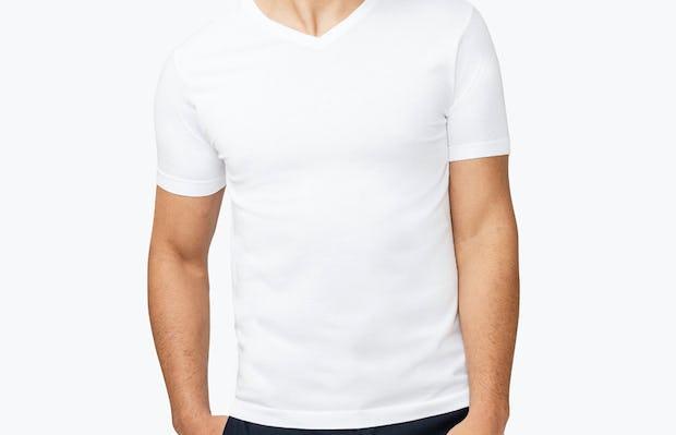 Men's White Atlas V-Neck Tee model with hand in pocket