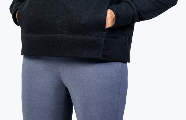 Women's Black Hybrid Fleece Funnel Neck on Model in Close-up of Kangaroo Pocket