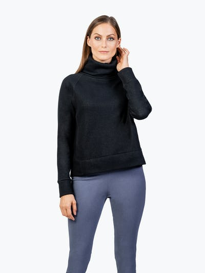 Women's Black Hybrid Fleece Funnel Neck on Model Adjusting Her Hair