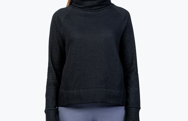 Women's Black Hybrid Fleece Funnel Neck on Model with Hands by Her Side