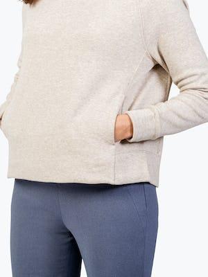 Women's Oatmeal Hybrid Fleece Funnel Neck on Model in Close-up of Kangaroo Pocket