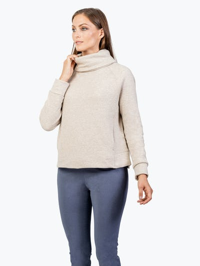 Women's Oatmeal Hybrid Fleece Funnel Neck on Model Touching Her Collar