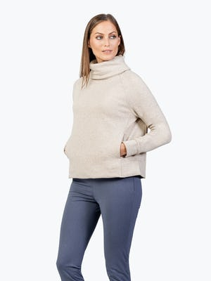 Women's Oatmeal Hybrid Fleece Funnel Neck on Model with Hands in Kangaroo Pocket
