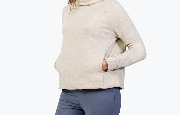 Women's Oatmeal Hybrid Fleece Funnel Neck on Model with Hands in Kangaroo Pocket