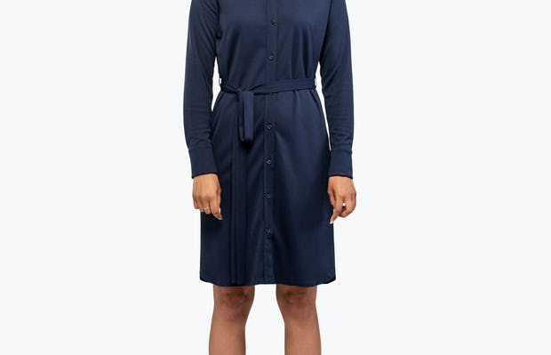 Women's Navy Apollo Shirt Dress on Model with Hands by Her Side