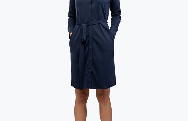 Women's Navy Apollo Shirt Dress on Model with Hands in Her Pockets