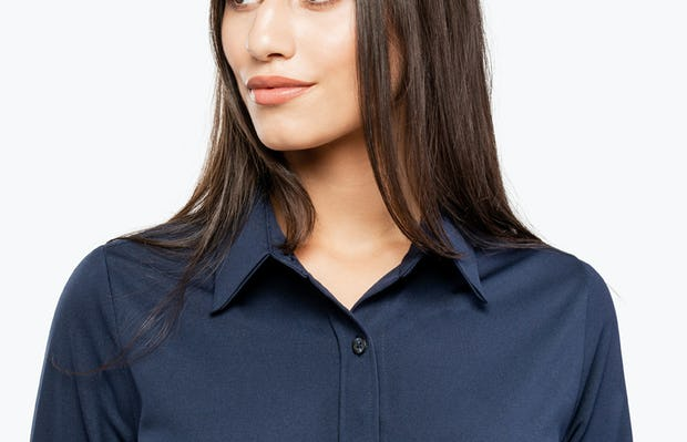 Women's Navy Apollo Shirt Dress on Model in Close-up of Collar Front