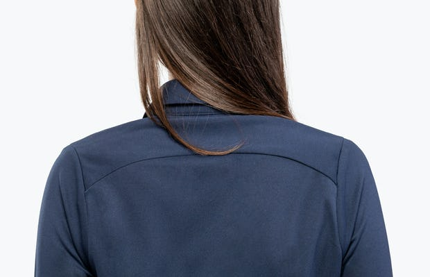 Women's Navy Apollo Shirt Dress on Model in Close-up of Back Collar