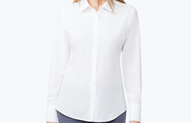 Women's White Juno Tailored Dress Shirt on Model Looking to Her Right