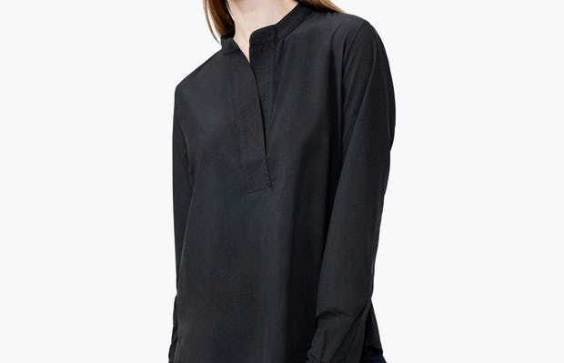 Women's Black Juno Popover on Model Looking to Her Right