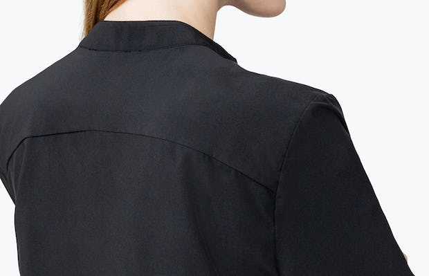 Women's Black Juno Popover on Model in Close-up of the Back of Her Shirt Collar