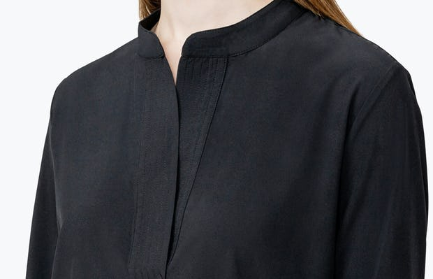 Women's Black Juno Popover on Model in Close-up of the Front of Her Shirt Collar