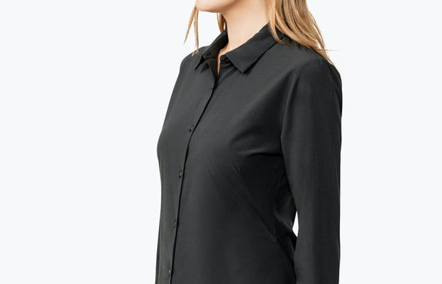 Women's Black Juno Tailored Dress Shirt on Model Turned to Her Right