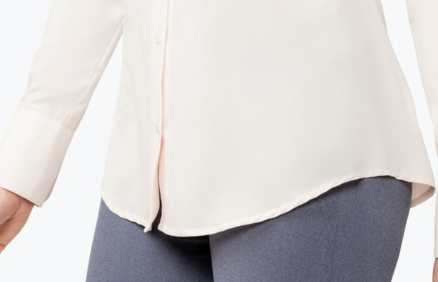 Women's Blush Juno Tailored Dress Shirt on Model in Close-up of Front Tails of Shirt