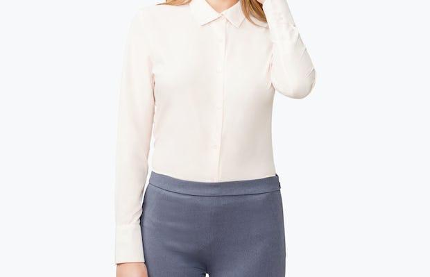 Women's Blush Juno Tailored Dress Shirt on Model Touching Her Left Ear