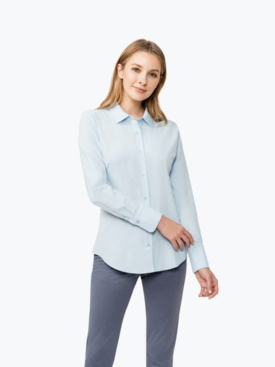 Women's Chambray Juno Tailored Dress Shirt on Model Touching Her Left Sleeve